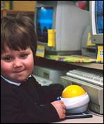 A nursery pupil with a computer
