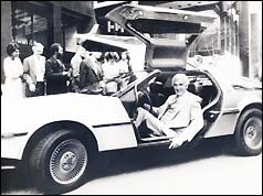John DeLorean in the DMC-12 produced by his company
