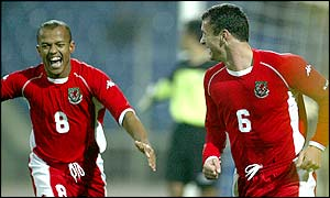 Robert Earnshaw rushes to congratulate goalscorer and captain Gary Speed after he gives Wales a ninth minute 1-0 lead