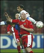 John Hartson in an aerial challenge