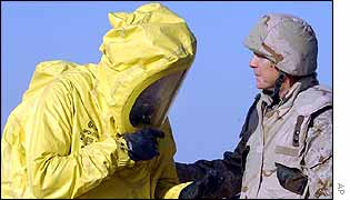 Czech soldier in protective suit with US officer