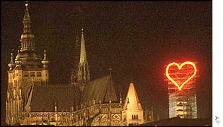 Neon heart above Prague castle