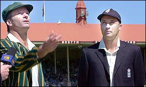 Australian captain Steve Waugh (left) spins the coin as his English counterpart Nasser Hussain watches