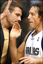 Steve Nash (right) celebrates his side's latest success with assistant coach Donn Nelson