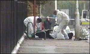Bomb disposal experts search the scene