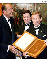 French President Jacques Chirac presents Mr Havel a copy of Nato's founding treaty