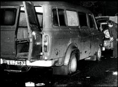 The minibus with back door flung open, windows smashed and bullet holes down the side