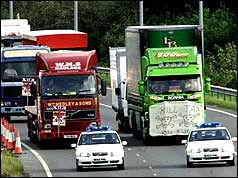 Lorries drive slowly along the A1 (PA)
