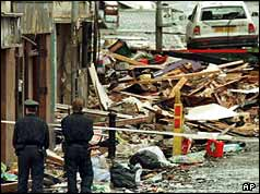 Police survey the devastation caused by the Omagh bomb in August 1998