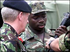 Colonel Mike Dent and Sierra Leonean soldier