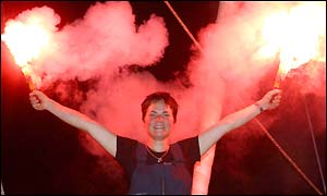 Ellen MacArthur lights flares in celebration after winning the Route du Rhum