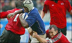 French flanker Serge Betsen is tackled by Canadian captain Al Charron