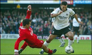 Markus Babbel tackles Fulham's Steed Malbranque