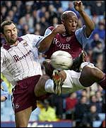 Dion Dublin puts the Hammers defence under pressure