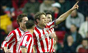 James Beattie accepts the home crowd's plaudits after his brace against Arsenal