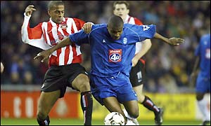 Clinton Morrison holds off Sunderland defender Phil Babb