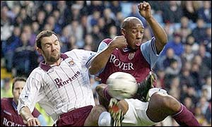 Dion Dublin challenges Christian Daley of West Ham