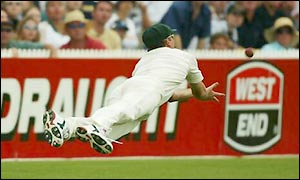 Glenn McGrath pulls off a stunning catch to remove Michael Vaughan for 41