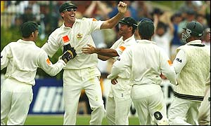 Glenn McGrath celebrates with team-mates