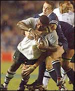 Fiji's Richard Nyholt is tackled by Scotland's Greame Beveridge