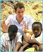 Blue Peter's Matt with some children in Africa