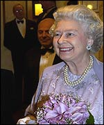 The Queen holds an ornamental mousetrap