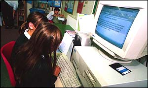 Children sitting at a computer