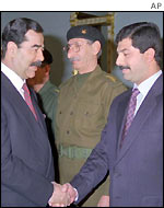 Saddam Hussein (left) with his younger son Qusay