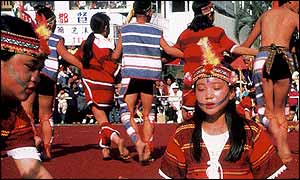 A group of aborigines performing for tourists, Taiwan