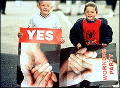 Two boys hold referendum posters in 1998