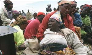 Women grieving for relatives killed by Aids