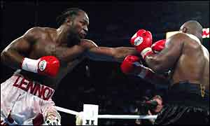 Lennox Lewis, heavyweight champ of the world, punishes Mike Tyson