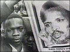 Steve Biko supporter with poster of black consciousness leader