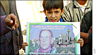A Palestinian boy with a poster protesting Iain Hook's killing