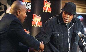 Mike Tyson (left) extends a hand to Clifford Etienne at Tuesday's media conference