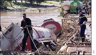 Oil tanker lies on the river bank after being swept away by floods near Mohammedia