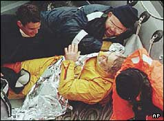 Tony Bullimore lying in the life raft with three rescuers