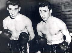 Ronnie and Reggie Kray in boxing outfits