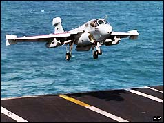 An EA-6B Prowler lands aboard the aircraft carrier USS Nimitz  in the Persian Gulf , Jan 1998