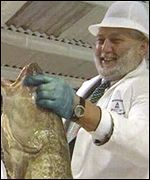 Franz Fischler with cod in hand