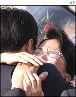Japanese kidnap victim Fukie Hamamoto hugs a relative on her return to Japan, October 2002