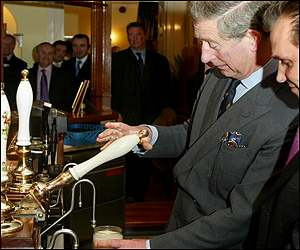Prince Charles pulling a pint at the pub in Poundbury, Dorset