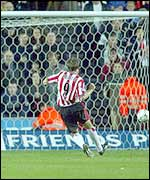 James Beattie slots home a penalty against Arsenal