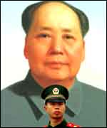 Chinese soldier and Mao portrait