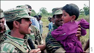 Tamil Tiger soldiers with child in Omanthai