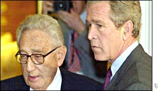Henry Kissinger (L) and George W Bush