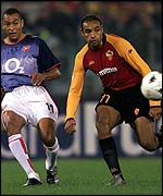 Arsenal's Gilberto Silva and Roma's Emerson compete for the ball