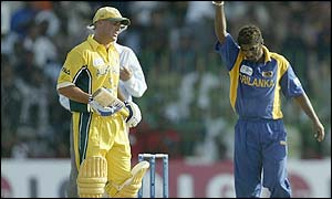 Muralitharan (right) celebrates taking the wicket of Damien Martyn