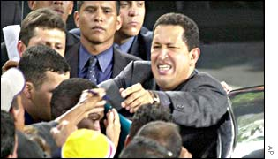 President Chavez surrounded by supporters