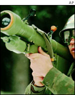 A soldier holds a shoulder-launched surface-to-air missile